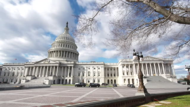 timelapse of the us capitol building - capital cities stock videos & royalty-free footage