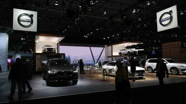 timelapse of the volvo booth with xc60 left and s90 centerright at the new york international auto show in new york ny on april 13 2017 - trade show booth stock videos & royalty-free footage
