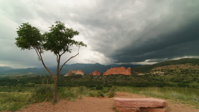 time-lapse of thunderstorm over pike's peak and the garden of the gods - storm cloud stock-videos und b-roll-filmmaterial