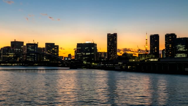 4k timelapse of tokyo cityscape at dusk. - sunset to night stock videos & royalty-free footage