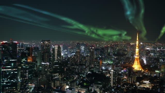 zeitraffer der tokyo tower mit aurora - polarlicht stock-videos und b-roll-filmmaterial