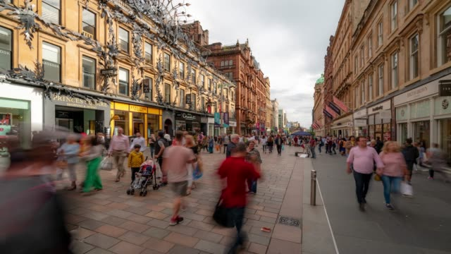 time-lapse of tourist pedestian crowded buchanan shopping street in glasgow scotland uk - high street stock videos & royalty-free footage