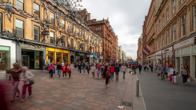 time-lapse of tourist pedestian crowded buchanan shopping street in glasgow scotland uk - city street stock videos & royalty-free footage
