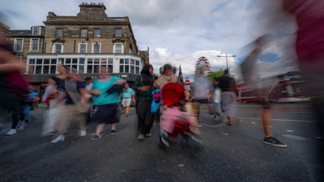 Time-lapse of Tourist Pedestian crowded Princes shopping street in Edinburgh Scotland UK