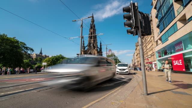 time-lapse of tourist pedestrian crowded princes shopping street in edinburgh scotland uk - tram stock videos & royalty-free footage