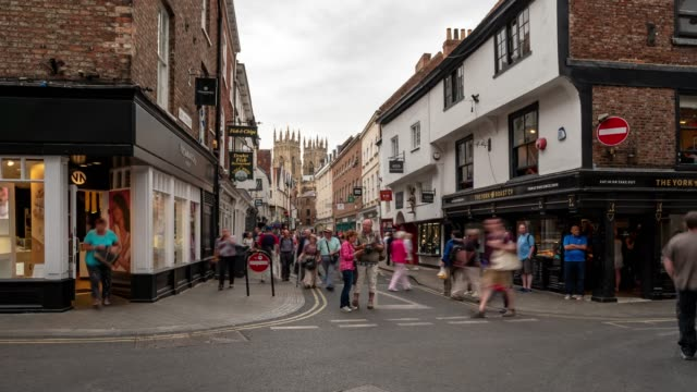 time-lapse of tourist pedestrian crowded shopping street in york yorkshire england uk. - town stock videos & royalty-free footage