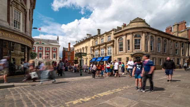 time-lapse of tourist pedestrian crowded shopping street in york yorkshire england uk. - yorkshire england stock videos & royalty-free footage