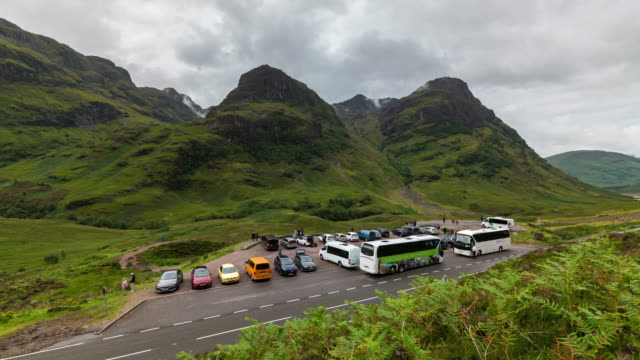 Timelapse of tourists and buses at the Iconic Three Sisters in Glencoe