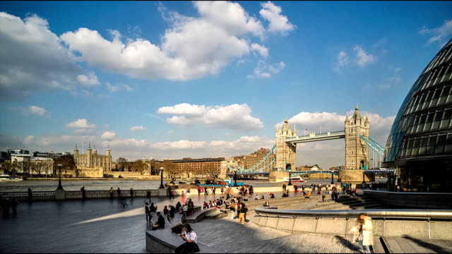 time-lapse of tourists and tower bridge and the city hall, london - london bridge england stock videos & royalty-free footage