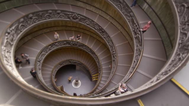 time-lapse of tourists on large spiral staircase - spiral staircase stock videos & royalty-free footage