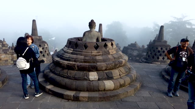 timelapse of tourists visit borobudur temple during celebrations for vesak day on may 18 2019 in magelang central java indonesia - buddha's birthday stock videos and b-roll footage