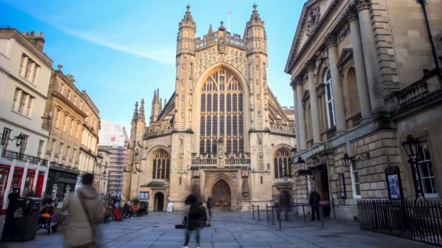 Timelapse of Tourists walking around Bath Abbey