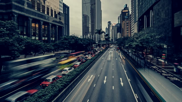 time-lapse of traffic along gloucester road, hong kong at dusk - wan chai stock videos & royalty-free footage