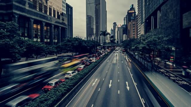 time-lapse of traffic along gloucester road, hong kong at dusk - hong kong island stock videos & royalty-free footage