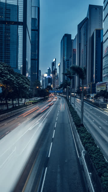 time-lapse of traffic along gloucester road, hong kong at dusk.for vertical displays - hong kong island stock videos & royalty-free footage