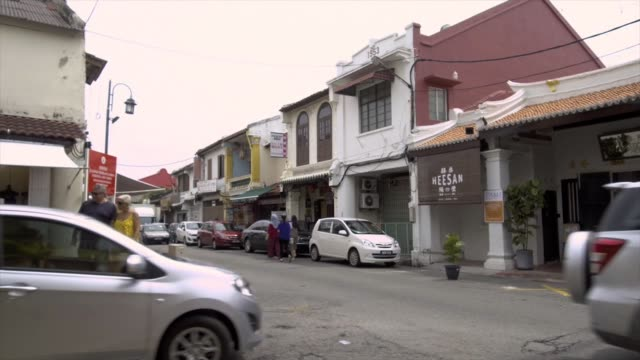 timelapse of traffic and pedestrians at jonker street in the chinatown area of malacca city malaysia on thursday july 27 2017 - malacca stock videos and b-roll footage