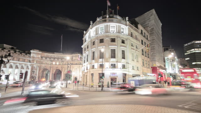 time-lapse of traffic around charing cross in london. - charing cross stock videos and b-roll footage