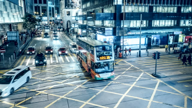 time-lapse of traffic crossing des veoux road central on hong kong island at night - central district hong kong stock videos & royalty-free footage