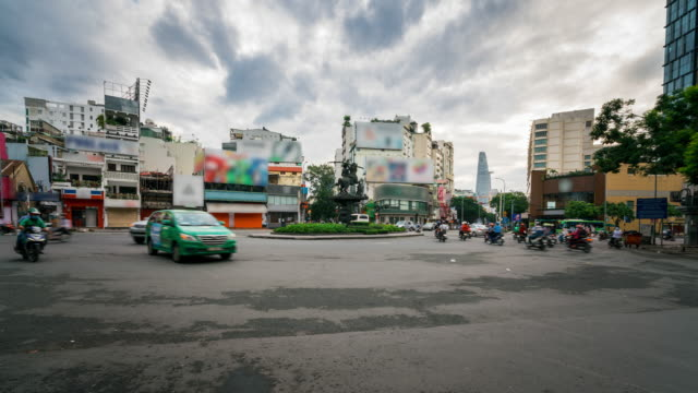 timelapse of traffic in ho chi minh city saigon, vietnam in morning - vietnam stock videos & royalty-free footage