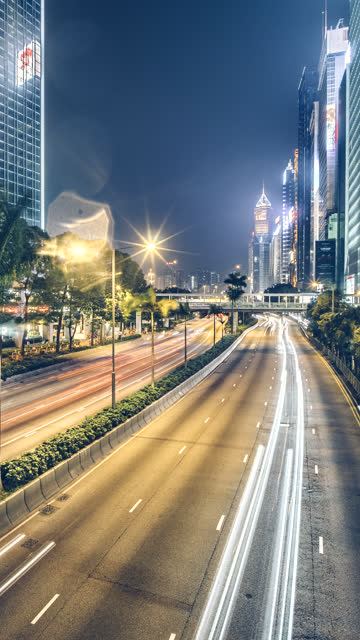 time-lapse of traffic on a rainy day along gloucester road on hong kong. for vertical displays - hong kong island stock videos & royalty-free footage
