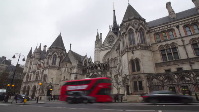 timelapse of traffic outside the court of appeal london - traffic time lapse stock videos & royalty-free footage