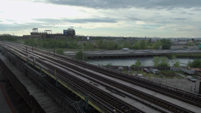 timelapse of train passing - flushing meadows corona park stock videos and b-roll footage