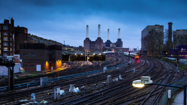 timelapse of trains and battersea power station, london - train stock videos & royalty-free footage