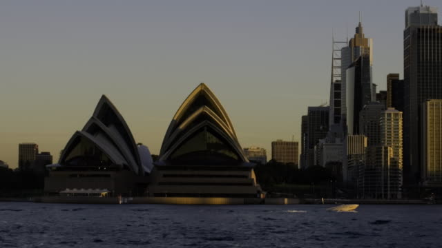 time-lapse of transition from day to night sydney harbour - ferry stock videos & royalty-free footage