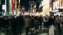 Timelapse of traveler traveling and shopping in Hongdae street market at Seoul, South Korea. Hong dae district is the most popular shopping market of teenage at Seoul city.