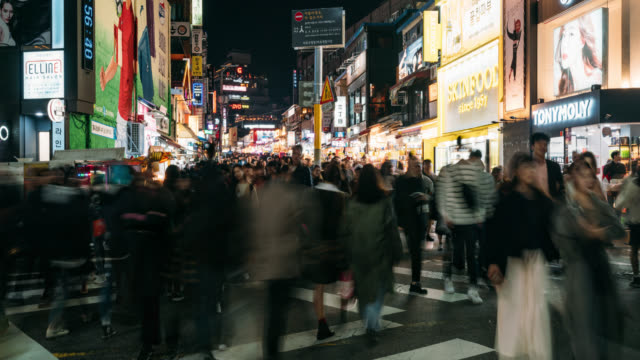 timelapse of traveler traveling and shopping in hongdae street market at seoul, south korea. hong dae district is the most popular shopping market of teenage at seoul city. - south korea stock videos & royalty-free footage