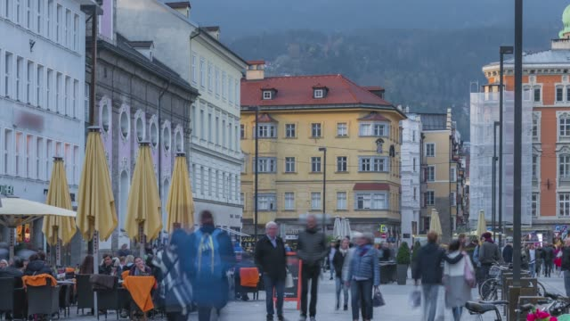 timelapse of traveller tourist walking in center square old town innsbruck is a popular gateway to the austrian alps - austrian culture stock videos & royalty-free footage
