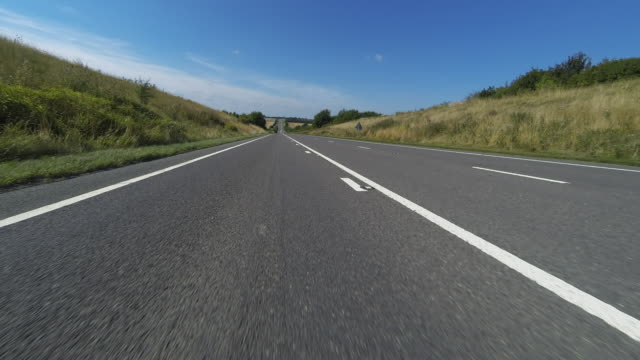 timelapse of travelling on a single carriageway road - road marking stock videos & royalty-free footage