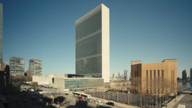 time-lapse of united nations building, new york, usa - united nations building stock videos and b-roll footage