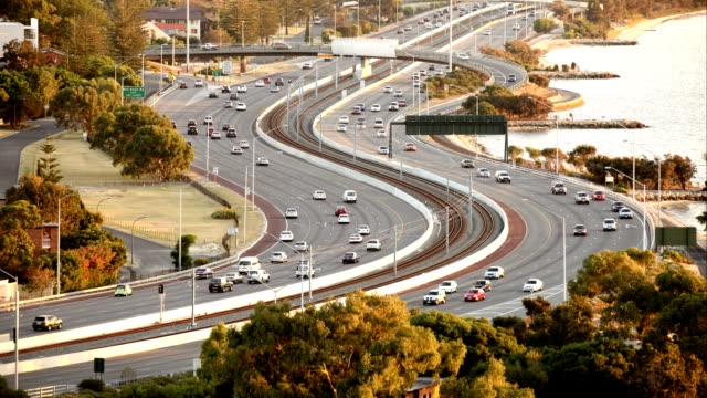 timelapse of urban traffic on highway in perth western australia - train vehicle stock videos & royalty-free footage