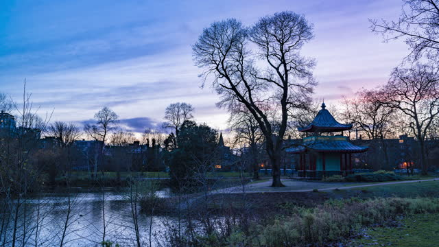 timelapse of victoria park with chinese pagoda in london - pagoda stock videos & royalty-free footage