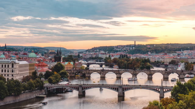 timelapse of vltava river and charles bridge in sunset in prague in czech republic - traditionally czech stock videos & royalty-free footage