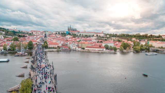 timelapse of vltava river and charles bridge in sunset in prague in czech republic - river vltava stock videos & royalty-free footage