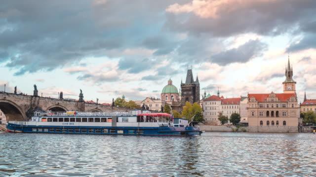 timelapse of vltava river and charles bridge in sunset in prague - river vltava stock videos & royalty-free footage