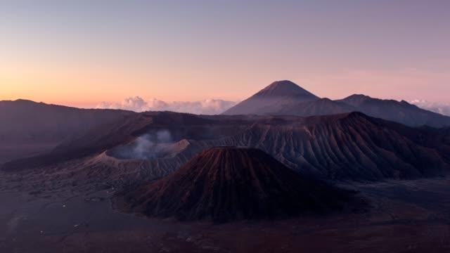 time-lapse of volcano mount an active, bromo, batok, semeru at dawn. bromo tengger semeru national park, east java, indonesia - bromo tengger semeru national park stock videos & royalty-free footage