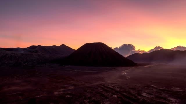 time-lapse of volcano mount an active, bromo, batok, semeru at dawn. bromo tengger semeru national park, east java, indonesia - mount bromo stock videos & royalty-free footage