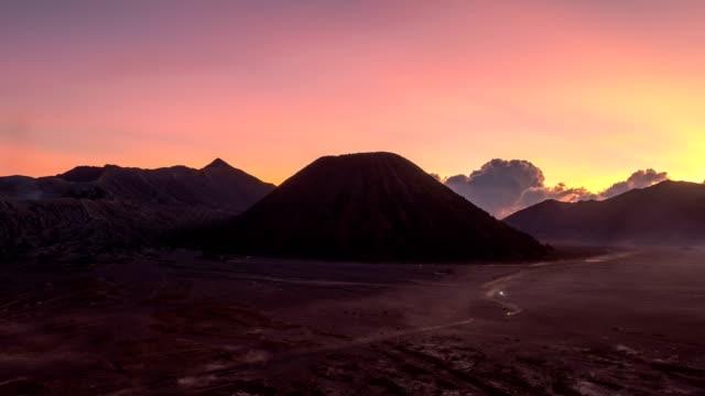 time-lapse of volcano mount an active, bromo, batok, semeru at dawn. bromo tengger semeru national park, east java, indonesia - mount semeru stock videos & royalty-free footage