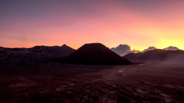 time-lapse of volcano mount an active, bromo, batok, semeru at dawn. bromo tengger semeru national park, east java, indonesia - indonesia volcano stock videos & royalty-free footage