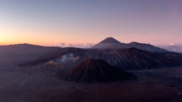 time-lapse of volcano mount an active, bromo, batok, semeru at dawn. bromo tengger semeru national park, east java, indonesia - soil stock videos & royalty-free footage