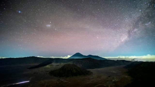time-lapse of volcano mount an active with milky way and light traffic at night. bromo tengger semeru national park, east java, indonesia - mount semeru stock videos & royalty-free footage