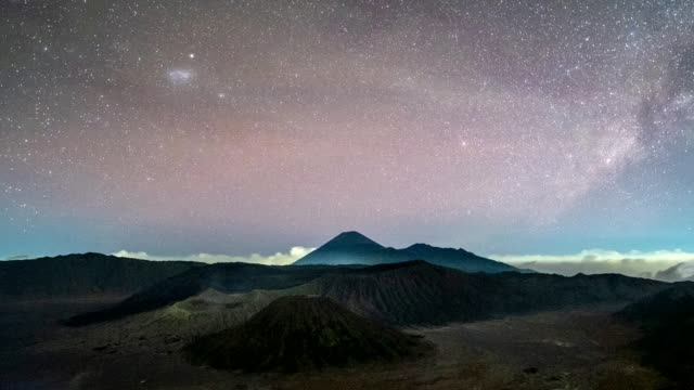 time-lapse of volcano mount an active with milky way and light traffic at night. bromo tengger semeru national park, east java, indonesia - indonesia volcano stock videos & royalty-free footage