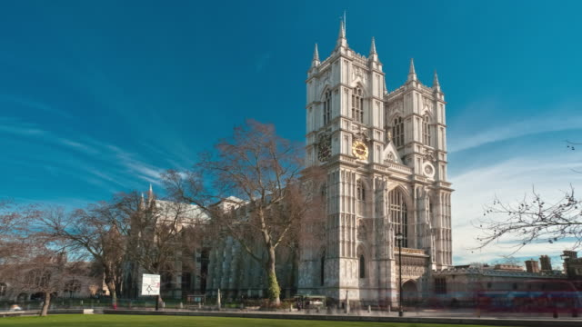 stockvideo's en b-roll-footage met time-lapse of westminster abbey under a blue sky in london. - westminster abbey