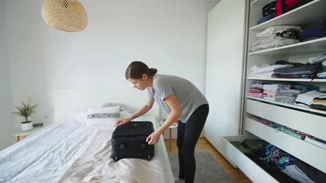 time-lapse of woman packing a suitcase in the bedroom - luggage stock videos & royalty-free footage