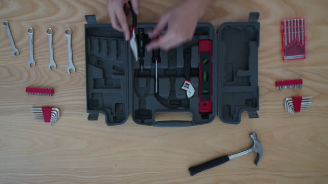 Time-lapse of Worker toolbox and tools overhead angle