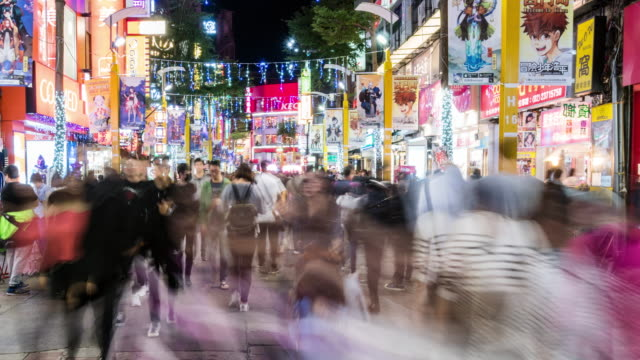 Timelapse of young customers wander at Ximending shopping street, Taipei, China