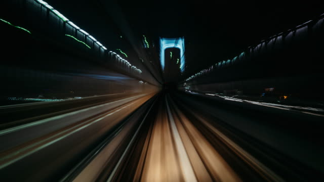 timelapse of yurikamome line in tunnel,tokyo, japan - inquadratura da un treno video stock e b–roll